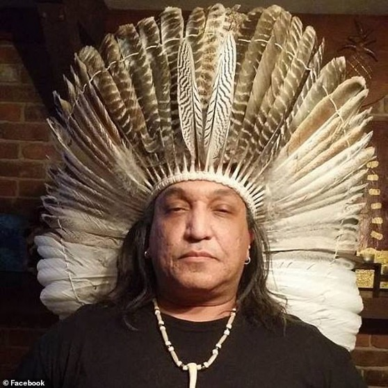 Male person with a headdress made of feathers