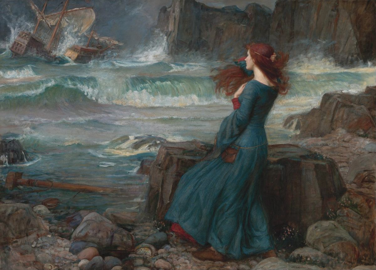red-haired woman facing the tempestuous water