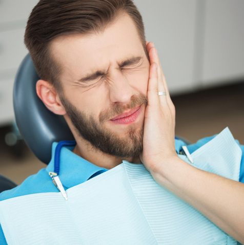 A patient getting treated for a dental emergency procedure