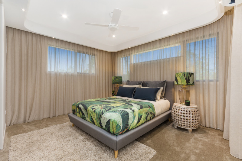 Master Bedroom at the MLH Elliot Springs Display Home with curved feature bulkhead and built-in LEDs