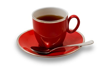 Full Red Teacup and Saucer Isolated on White