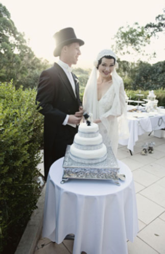 Ebony created the three tier wedding cake with an art deco style cake topper