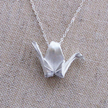 crane necklace Friday News Roundup