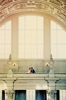 bride-and-groom-kissing-at-san-francisco-city-hall