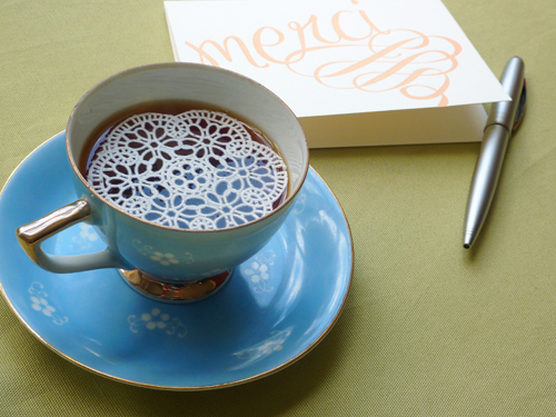 edible lace doily in teacup
