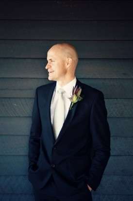 Groom in navy suit with silver tie