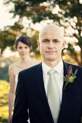 Groom in navy suit with white shirt and silver tie