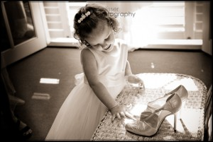 little girl touching shoes