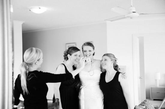 bride with bridesmaids in black