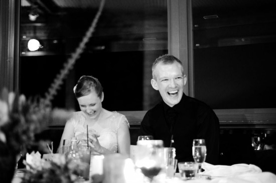 groom laughing at wedding speech