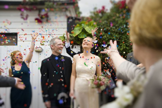 newlyweds with confetti