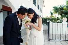 bride-and-groom-smelling-bouquet