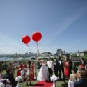bride and groom with red balloons
