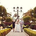 bride walking with her parents