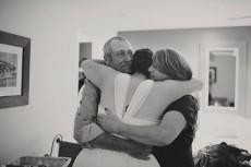 bride hugging parents