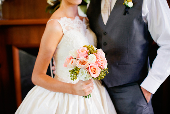 around a simple peach bouquet and the most beautiful lace wedding gown