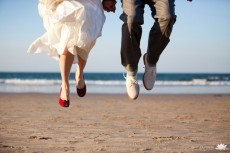 jumping bride and groom