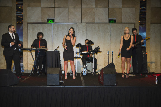 Band performing with 'normal' lighting