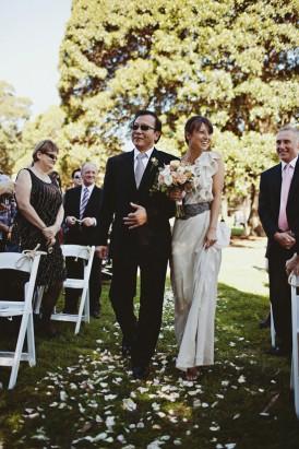 bride walking down park aisle