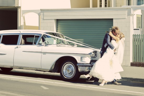 Kissing by the 1958 Caddy
