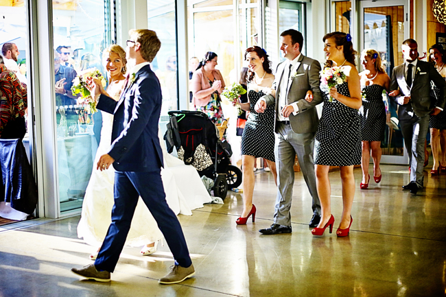 The bridal party enters the reception to 'Love Train' by the Ojays