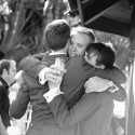 groomsmen hugging groom