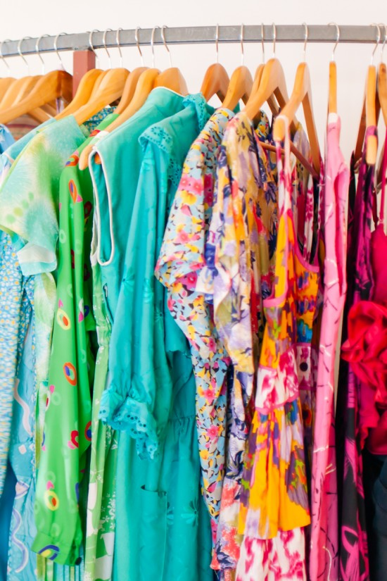 Rack of floral vintage dresses bursting with Spring colours at Dolly Up Vintage Emporium