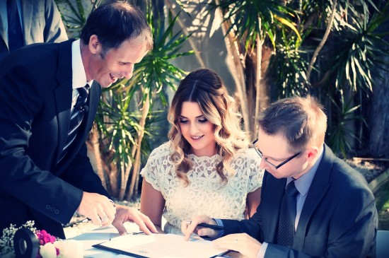 The Panorama Wedding with Celebrant Jamie Eastgate signing 550x365 10 Questions To Ask When Choosing Your Wedding Celebrant
