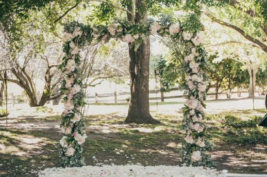floral altar arch 550x366 Sam & Amandas Romantic Wedding In Berry