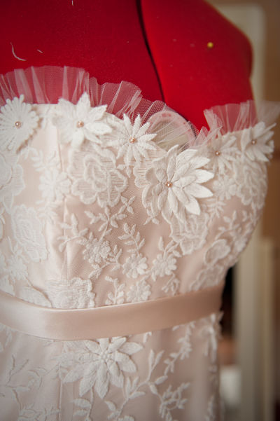 The pleated tulle and hand placed lace