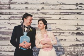 bride and groom with hot water bottles