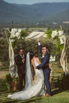 groom fist pump after first kiss
