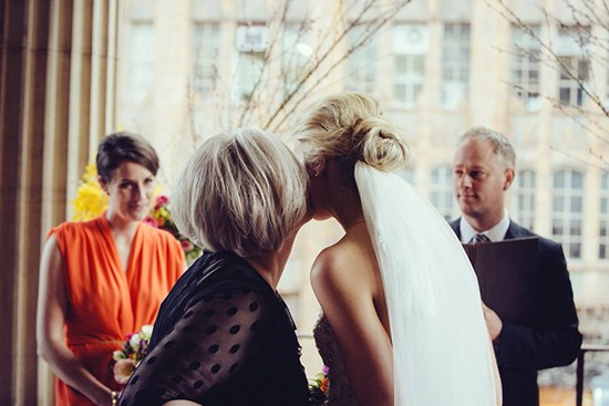 mum kissing bride louisa bailey