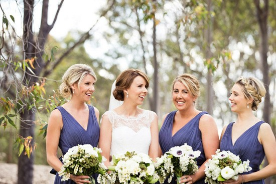 blue with bridesmaids in deep blue