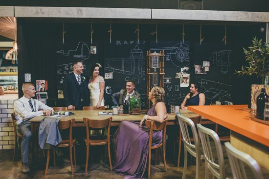 bridal party against chalk board