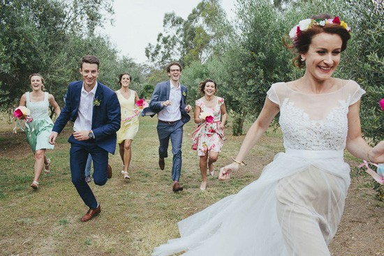 bridal party running