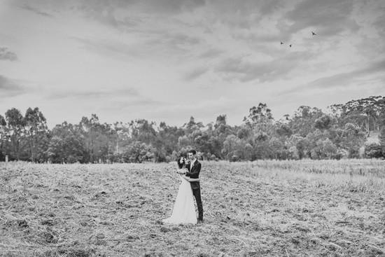 bride and groom in australian field