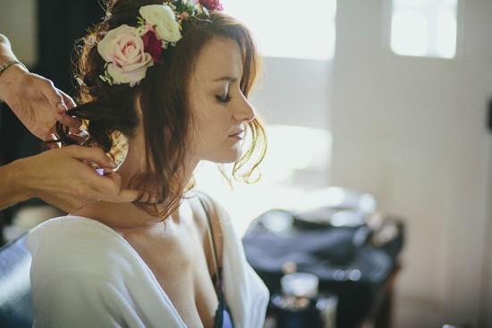 bride having flower crown pu in