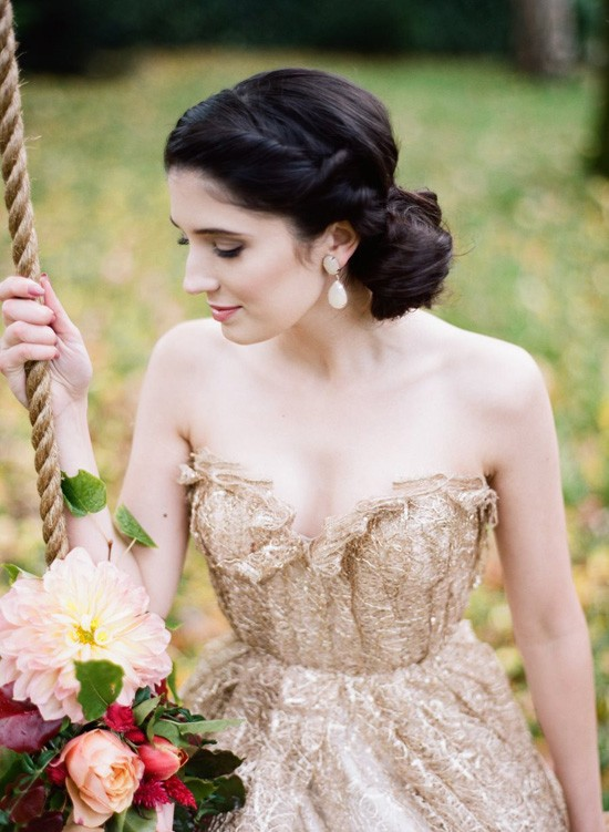 bride in gold on swing