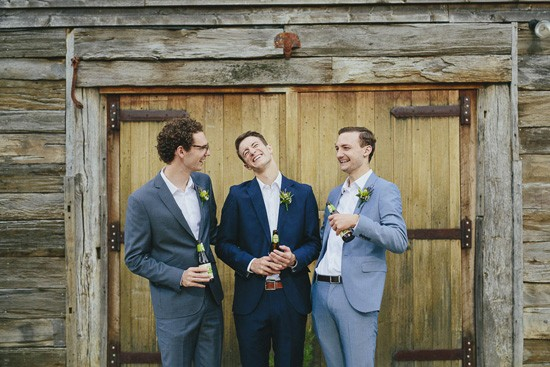 groom and groomsmen with barn