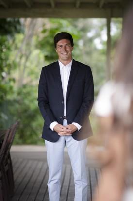 groom in navy blazer pale blue pants