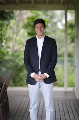 groom in pale blue pants