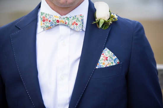 groom with floral bowtie