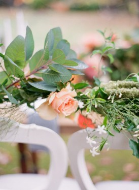 peach rose with greenery