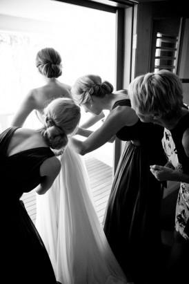 putting putting on wedding dress