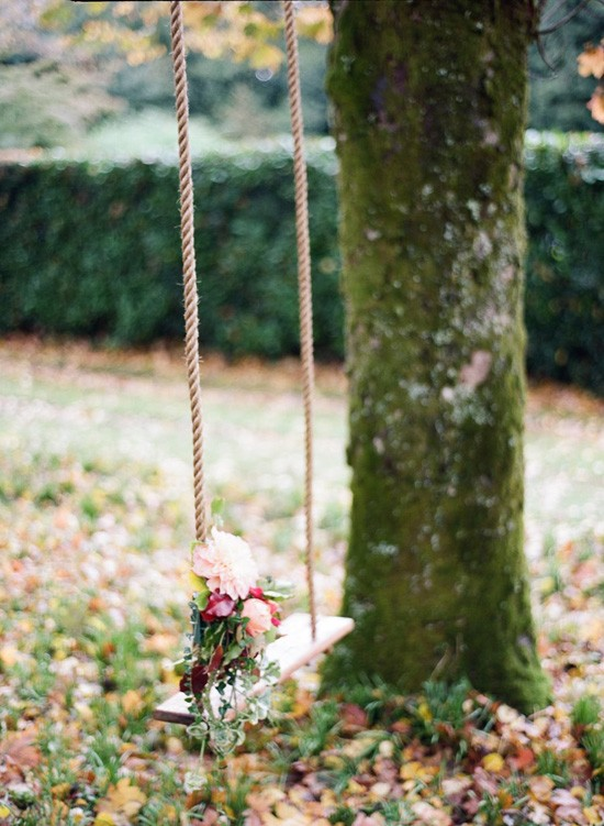 swing decorated with flowers