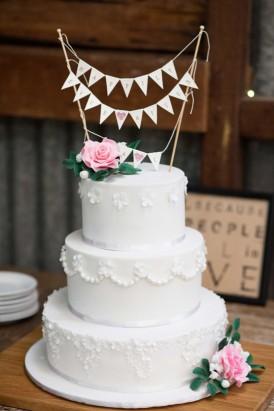 white wedding cake with butning