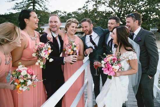Beach wedding with apricot bridesmaid dresses