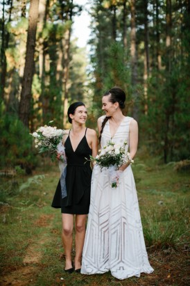 Bride and bridesmaid in forest wedding