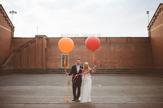 Bride and groom with baloons